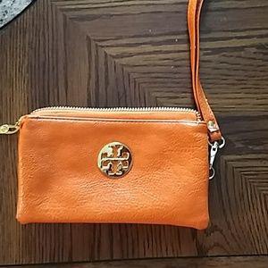 Handbags - Small, orange, wristlet. With gold decorations.